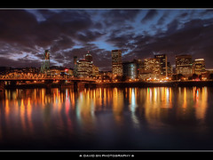 Portland Oregon Downtown Skyline at Night (David Gn Photography) Tags: sky reflection night clouds oregon river portland downtown cityscape officebuildings hawthornebridge pdx willametteriver hdr eastbankesplanade portlandskyline sigma1020mmf35exdchsm canoneosrebelt1i