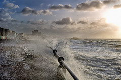 stormy seafront, brighton & hove, england (Laurence Cartwright) Tags: uk england sun storm beach clouds sussex pier photo brighton waves wind hove photograph esplanade promenade splash seafront beachhuts hightide drenched laurencecartwright lawrencecartwright