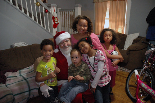 Santa, Two Men and a Truck, and The Salvation Army made a suprise visit to some very children on Christmas Eve.
