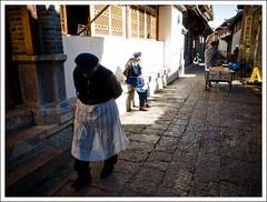 afternoon (-{ thus }-) Tags: china street winter people woman sunlight color digital yunnan ricoh 2009 lijiang   stoneroad grd3 thusihaveseen grdiii