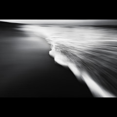 Wave Panning (Alistair Bennett) Tags: sunset seascape beach mono evening coast northumberland motionblur handheld desaturated marmite seatonsluice canonefs1022 wavepanning gnd075he