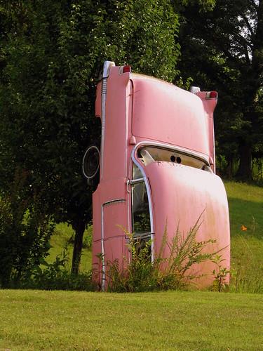 Half of a pink Cadillac