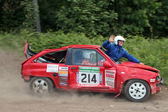Ouch... (Edd Cope) Tags: nottingham red 20d smile nova robin forest canon happy smash funny crash rally helmet wave damage hood driver roll amusing dust 2009 gravel vauxhall sherwood rallying dukeries codriver