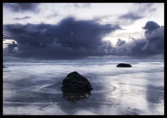 Elements (Mark Emirali) Tags: ocean light sea newzealand sky cloud seascape reflection nature water canon landscape rocks mood blues auckland nz tones westcoast 1022mm 30d copyrighted canon30d nothdr pleasedonotusewithoutmypermission maloe4 maloephoto maloephotography markemirali