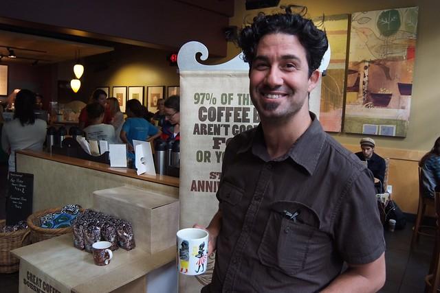 Derrick bringing his coffee into Starbucks