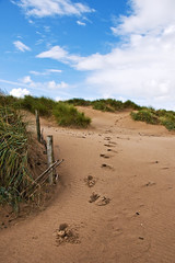 Footprints (Etrusia UK) Tags: uk greatbritain sea sky beach grass wales clouds fence geotagged sand nikon britishisles zoom unitedkingdom britain footprints wideangle gb cloudysky pictureperfect flintshire nwn vegatation d300 nikkorlens 18200mm nikonlens vrlens nikon18200mm nikkor18200mmvr nikkor18200mm nikon18200mmvr 18200mmlens nikond300 geo:lat=5335555 geo:lon=3318387