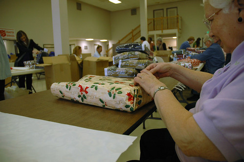 Betty Jo Vanek wraps presents for The Salvation Armys Gift of Warmth event Wednesday, Dec. 2, 2009.