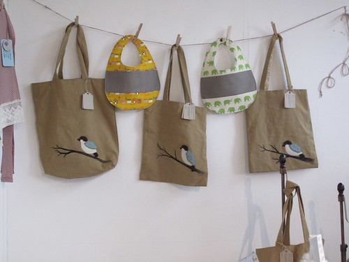 Bags by Sylvia Min, Bibs by Chase Clark