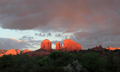 Pink Rain over Cathedral Rock (sedonakin) Tags: pink light sunset arizona sky orange sun sunlight southwest nature clouds canon landscape purple horizon vista redrocks glowing cathedralrock rainclouds oakcreekcanyon hotpink julielake