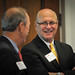 Greater Raleigh Chamber of Commerce CEO Harvey Schmitt (r) chats with Itron's Ed White.