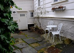Time for coffee? (halifaxlight) Tags: norway bergen citycentre urban house patio table chairs windowbox flowers shrub door
