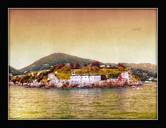 Il fortino (in eva vae) Tags: old sea italy lighthouse seascape nature water colors yellow rocks italia mare waves liguria giallo 1001nights rocce colori hdr textured blockhouse onde fortino tonemapping abigfave aplusphoto artofimages sailsevenseas