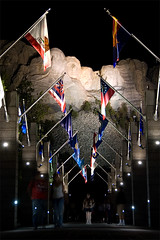 Avenue of Flags (photo.klick) Tags: light tourism night southdakota blackhills memorial union flags spotlight carve photoblog sd granite keystone avenue mtrushmore jol katsingercom