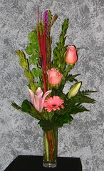 "#25ED $50 Roses, gerbera daisy, liatris, sorbonne lily, bells of Ireland, and a variety of foliage make up this lovely cylinder vase arrangement. • <a style=""font-size:0.8em;"" href=""http://www.flickr.com/photos/39372067@N08/3880364446/"" target=""_blank"">View on Flickr</a>"