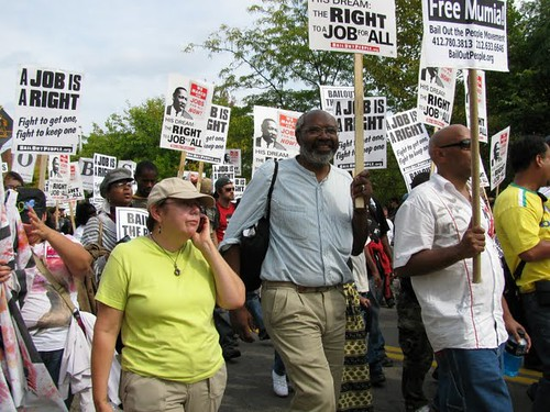 Abayomi Azikiwe, editor of the Pan-African News Wire, with IAC co-director Sara Flounders, covering the National March for Jobs in Pittsburgh on September 20, 2009. The event kicked off a week of protests surrounding the G20 summit. (Photo: Alan Pollock) by Pan-African News Wire File Photos