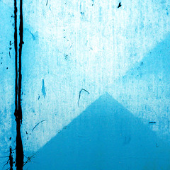 Camping by a pyramid (daliborlev) Tags: blue abstract texture metal square paint pyramid urbandecay brno campfire damage damaged garagedoor mundanedetail humanfigure