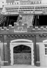 Middle street 3, 1977 (gandalphthegrey) Tags: bw rooftops demolition hastings 1970s om1 middlestreet