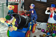 When the local Vicar (and part-time clown), the Reverend Bernard, agreed to be Canonised, this was not what he had in mind! (Chris H#) Tags: blue red snow black green yellow canon miltonkeynes matches clowns bang baubles s3000 christmasfestival nikond5000 snortypeople