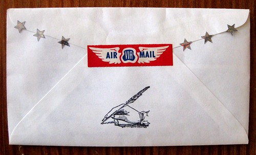 Via air mail, with wings
