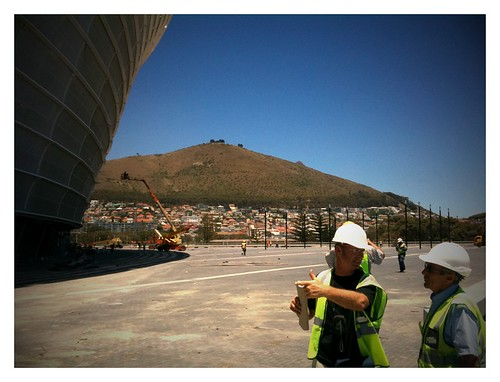 Workers discuss some of the final touches for the Cape Town Stadium