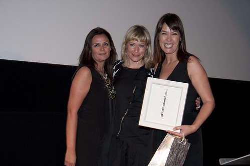 Mabel Lozano and her producer Monica Lopez receive the Grand Prize from 2010 winner Dearbhla Glynn