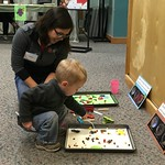 The Genetics Program challenged visitors to a Battle of the Beaks, where they figured out which tool worked best for picking up different kinds of food in several different environments. Photo: Holly Menninger.