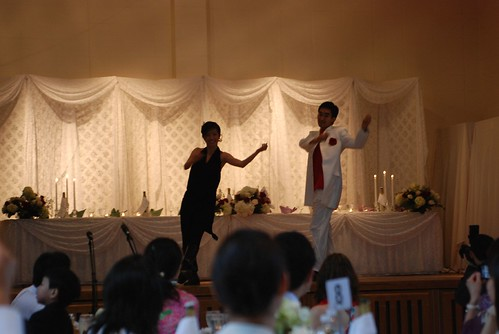 Michael and Ellein are both fabulous dancers! When they entered the reception, they had changed out of their wedding clothes and into these outfits (they also had top hats!).  Ellein choreographed the dance - it was amazing. One of their friends posted up a video on Facebook but unfortunately its not on YouTube.  If I can get a copy Ill post it up here!