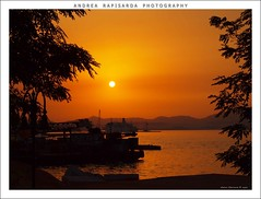 sunset at the port (Andrea Rapisarda) Tags: sunset sea port geotagged tramonto mare hellas olympus explore greece porto grecia kerkyra frontpage notripod crepuscolo corf noprocessing limani nohdr nothdr fourthird mywinners straightoutofmycamera quattroterzi rapis60 andrearapisarda crepuscolosunsetssunrisesnights olympuse620 geo:lat=39626846 geo:lon=19912205