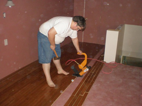 20090806 - Alex nailing attic room flooring