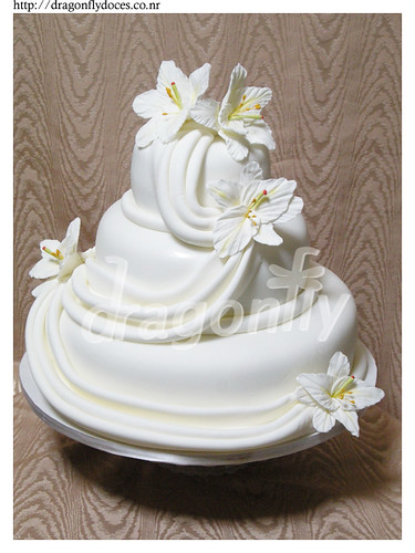 A wedding cake with gumpaste lilies and drapes I 39m actually pretty tired of