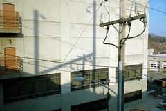 (alankin) Tags: windows light 15fav germantown philadelphia geometric lines buildings geotagged shadows pennsylvania angles trains nikond70s powerlines fromthetrain inpassing walls nikkor septa pylons r7 50views postindustrial urbanlandscape inmotion utilitypoles 24mmf28af bayntonstreet niknala electricpowertransmission chestnuthilleastline 13march2008 1700206bmu