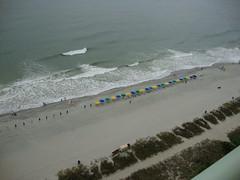 We enjoyed watching the lifeguard put up the umbrellas