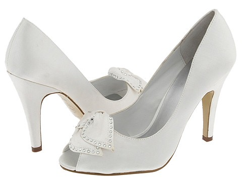 High heel wedding shoes with a ribbon at the end.