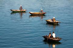Vendor Flotilla (CJ Dias Abeyesinghe) Tags: morning shells boys youth rural boats eos golden boat women floating villages vietnam rowing selling halong halongbay vendors wares 450d ef70200mmf4lisusm flickrchallengegroup flickrchallengewinner