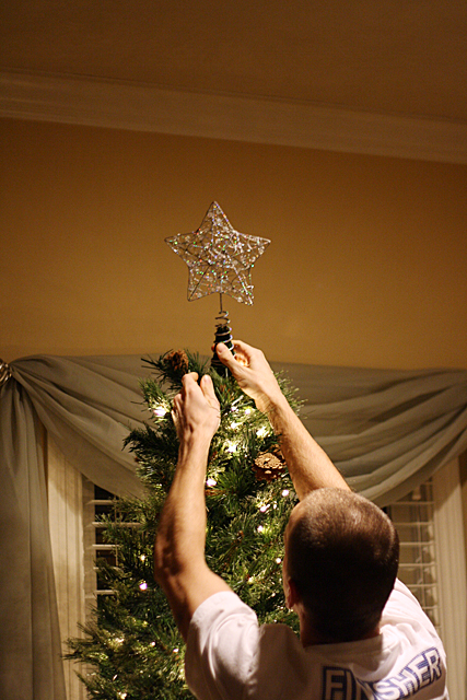 josh putting up the star