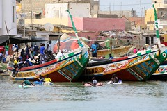 floaters (daniel.virella) Tags: floats fishing boats atlantic painted folk popular culture guetndar saintlouis senegal africa westafrica river children people play picmonkey