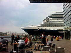 Eurodam leaving Amsterdam (screenpunk) Tags: city cruise people urban streets holland amsterdam outside scenery europa europe terrace candid nederland thenetherlands citylife streetlife drinks starferry dailylife mokum stad muziekgebouw hollandamericaline screenpunk eurodam socialgeometry obasail2010