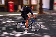 Dappled shade (jeremyhughes) Tags: road street motion london bike bicycle speed movement nikon track pattern cyclist shade fixed fixie fixedgear messenger courier panning rider dappled trackbike bikemessenger d40 fixedwheel bikecourier