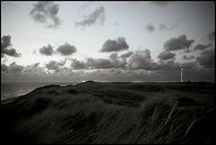 (HisDivineGrace) Tags: sea grass strand landscape denmark faro evening coast wind wolken northsea dmmerung dnemark nordsee leuchtturm kste abends lightfire danimarca windig jtland dhnen holmlandsklit norrelyngvigcamping2009 weiserleuchtturm