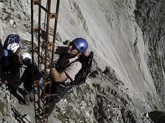 Climbing the last ladders on via ferrata