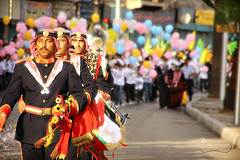 The Jordanian Armed Forces Band.. (SonOfJordan) Tags: old city light people music blur colour boys festival century canon balloons eos centennial downtown bokeh cityhall flag amman band parade jordan theme 100 colourful bagpipes xsi gam    450d      samawi  sonofjordan shadisamawi  jordanarmedforces   wwwshadisamawicom