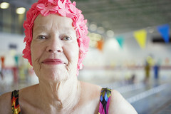 Elderly Woman in Colorful Bathing Cap (homecaregiverstore@gmail.com) Tags: pink portrait people 1 women eyecontact swimmingpool indoors elderly swimmer whites recreation females adults retirement retirees headandshoulders headgear vitality senioradult headandshouldersportrait healthiness physicalfitness swimcap 70sadult 80plusadult seniorwoman activeseniors