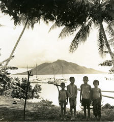Children of Makian Island with Moti Island in the background