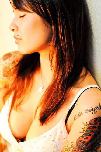 Nice girl with arm tattoo design