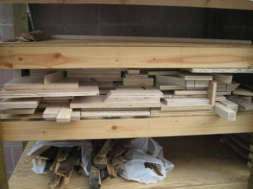 scrap plywood on log drying shelf