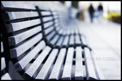 focus benches (andreas gessl) Tags: vienna wien field canon bench 50mm austria focus dof bank depthoffield f18 benches depth bokehhearts bokehmasterpiece