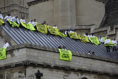 Greenpeace volunteers on the roof of Parliament by Greenpeace UK