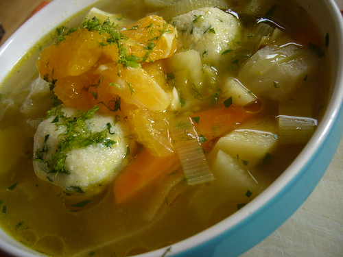 veggie soup with orange slices.