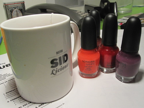 Cup of tea (free) with my new nail polishes (not free)