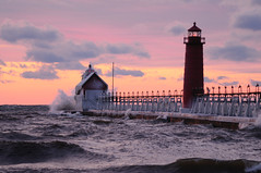 (Neil Weaver Photography) Tags: winter sunset lighthouse ice clouds pier waves dusk michigan greatlakes grandhaven